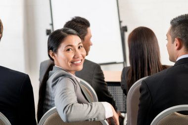 Vietnamese business lady attending meeting