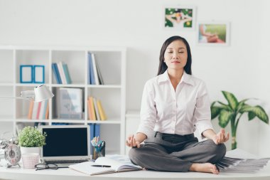 Female office worker meditating