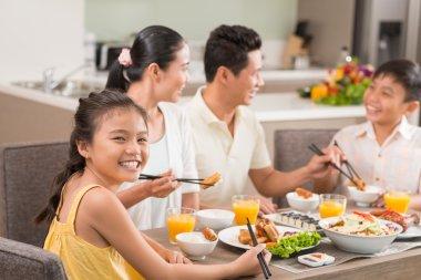 Vietnamese girl enjoying national food