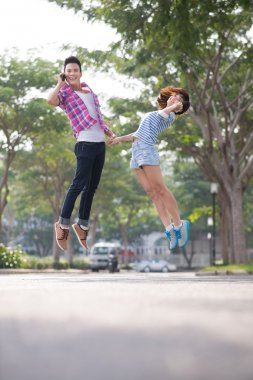 Vietnamese young couple jumping