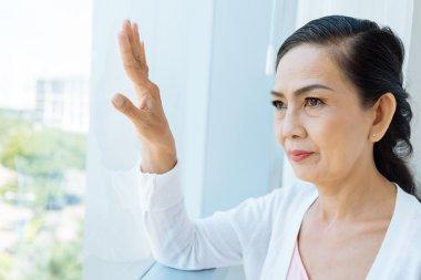 Contemplating Asian woman