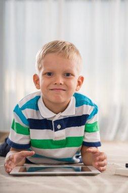 Boy with a digital tablet