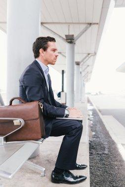 Businessman at bus station