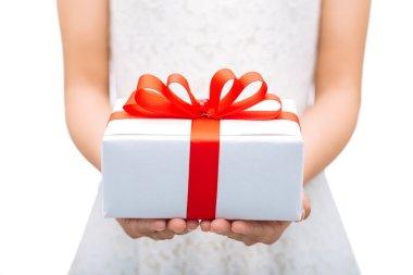 Female hands holding gift box stock vector