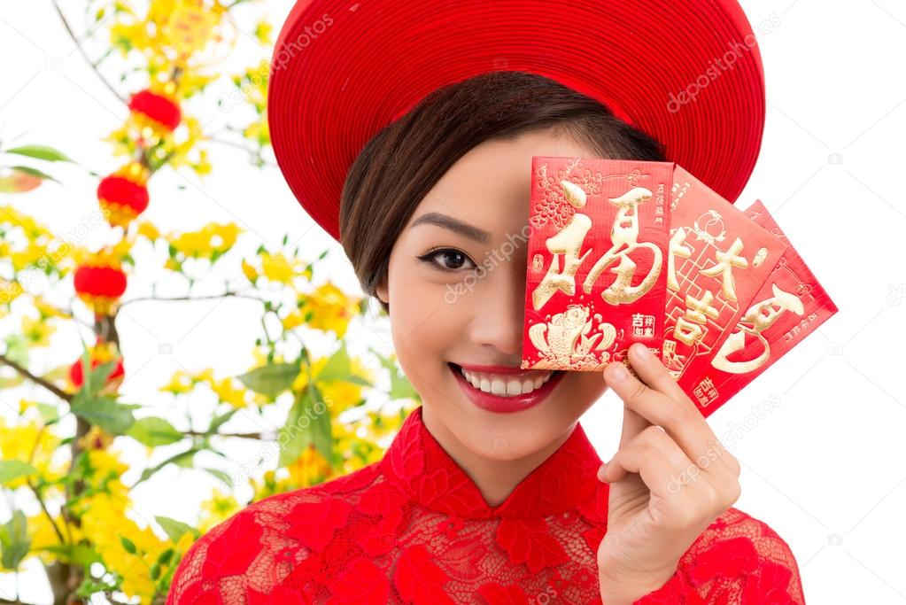 Vietnamese woman with tet greeting cards stock photo close up portrait of vietnamese young woman holding tet greeting cards photo by dragonimages m4hsunfo