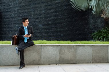 Asian businessman texting