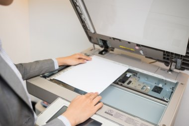 Woman copying document