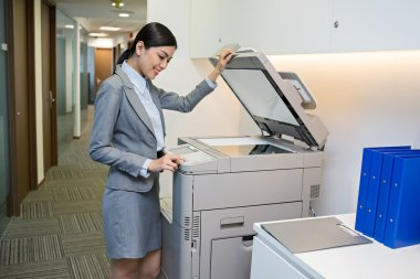 Secretary scanning a document