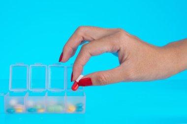 Hand putting capsule