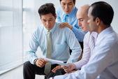 Executives reading contract