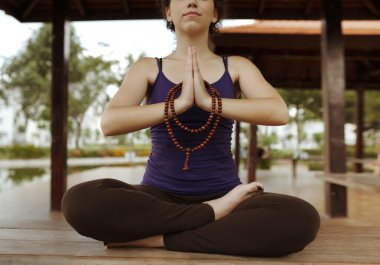 Meditating woman with rosary