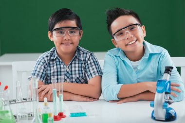kids ready to perform chemical experiment