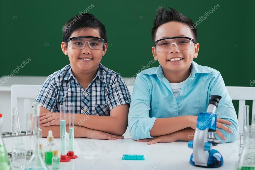 Asian boys in goggles at the desk