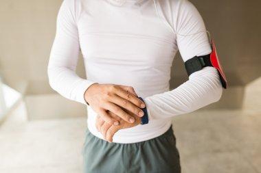 sportsman using fitness tracker