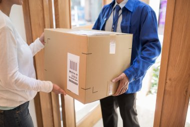 Delivery man bringing big package