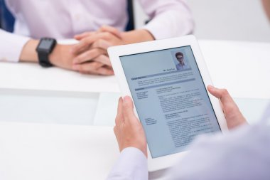 employer reading cv of job candidate