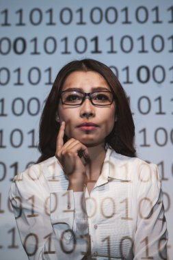 female scientist looking at the binary code