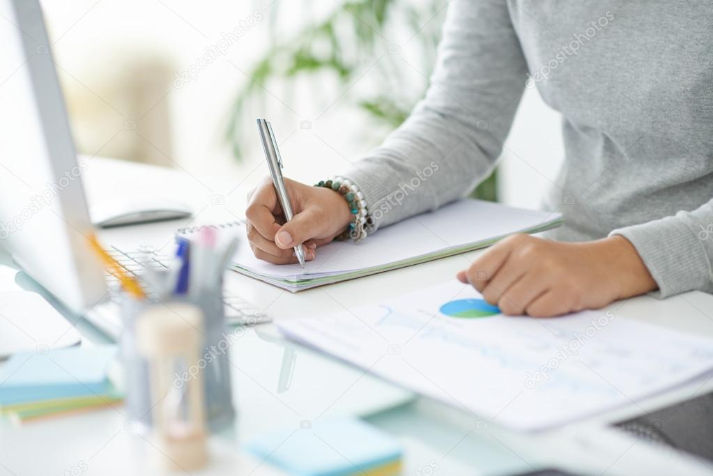 Business person making notes — Stock Photo © DragonImages