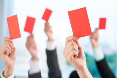 Business people showing red cards