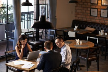 Restaurant owners Analyzing earnings