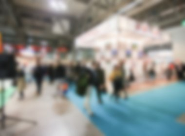 Trade show background with an intentional blur effect applied.