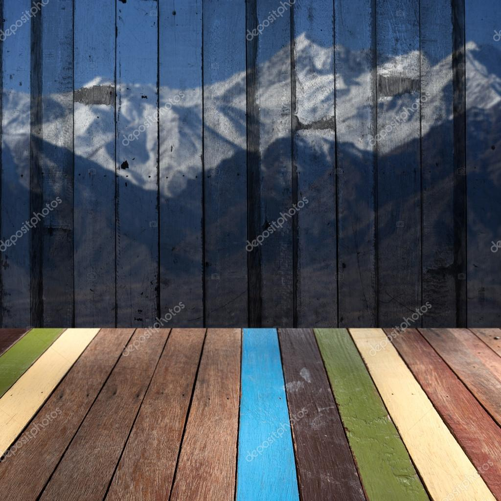 Wood table top on snow mountain background montage concept