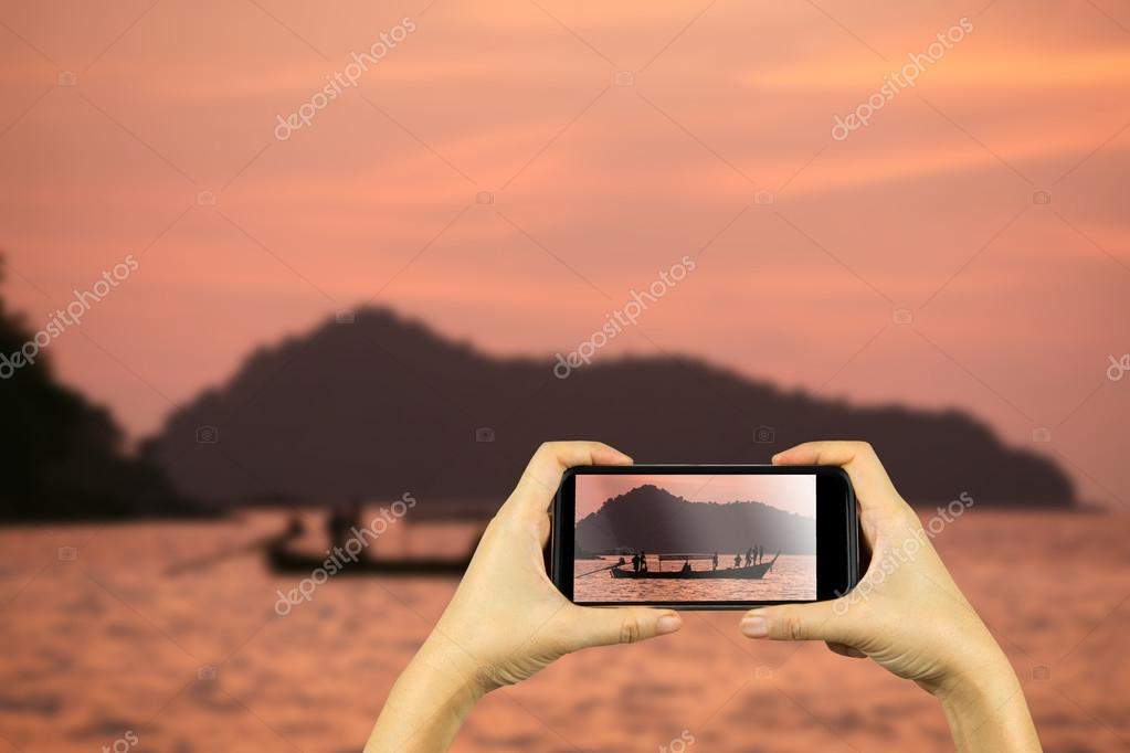 Taking photo on smart phone concept.