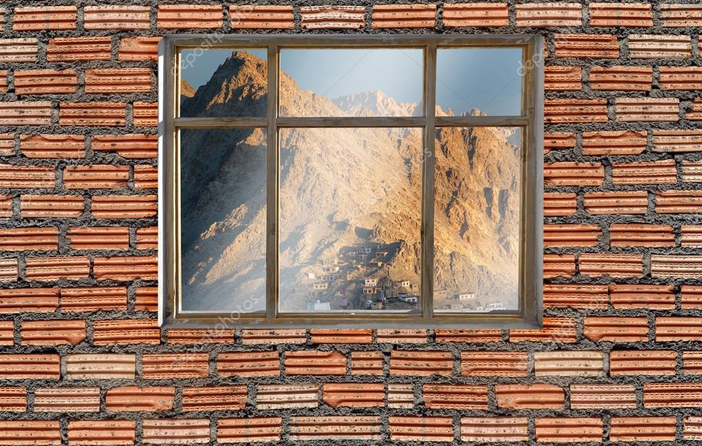 window on brick wall with leh ladakh mountian