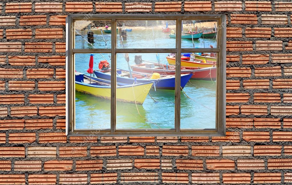 window on brick wall with seascape