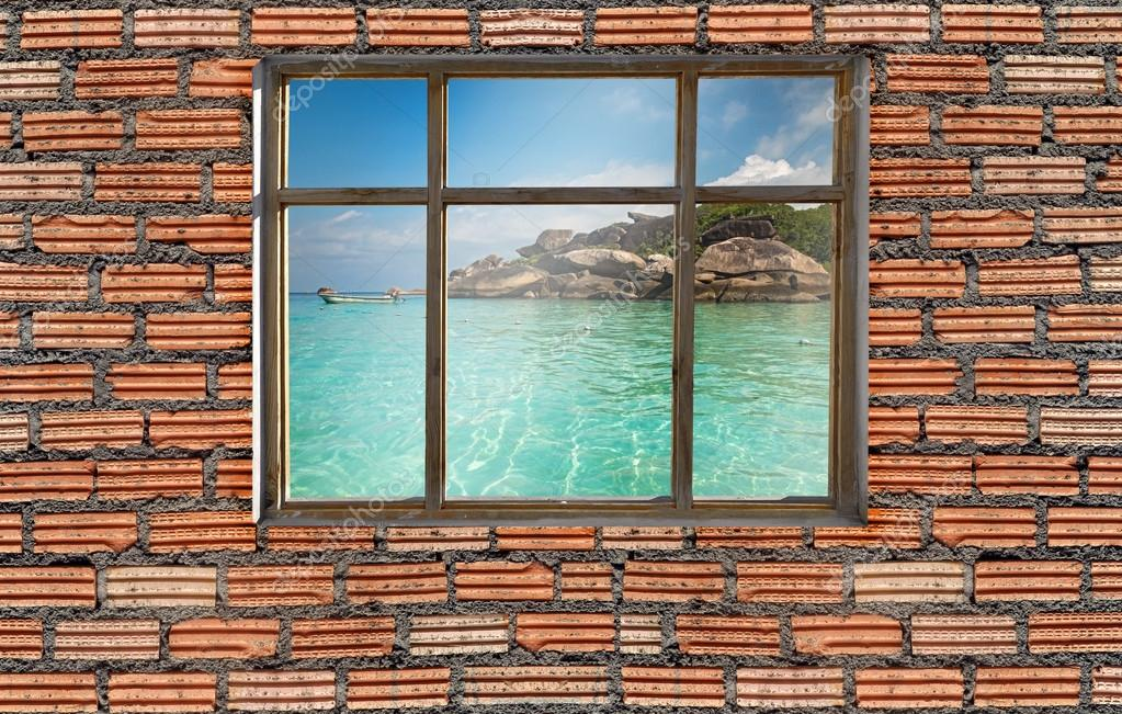 window on brick wall with similan seascape