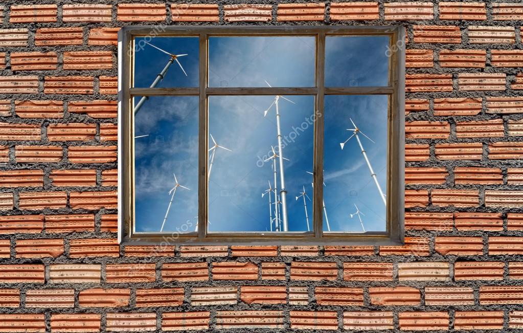 window on brick wall with wind turbine