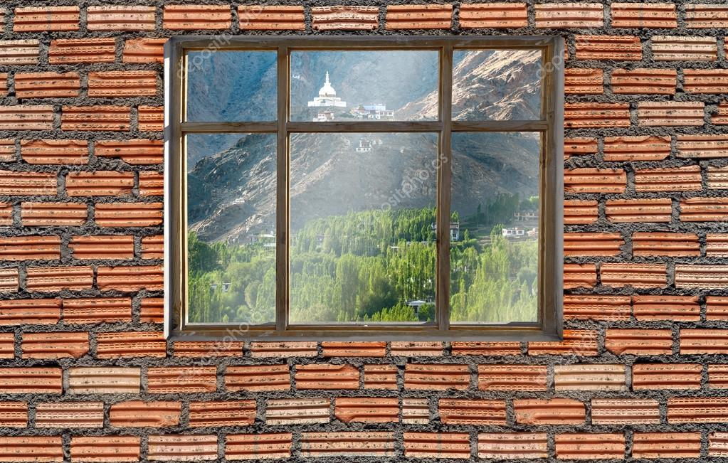 window on brick wall with leh ladakh mountian