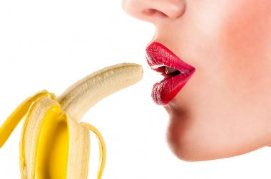 Sexy woman eating banana