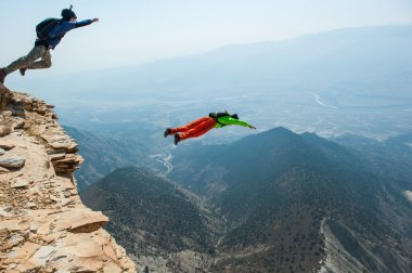 Base-jumpers in mountains