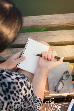 Young woman writing journal