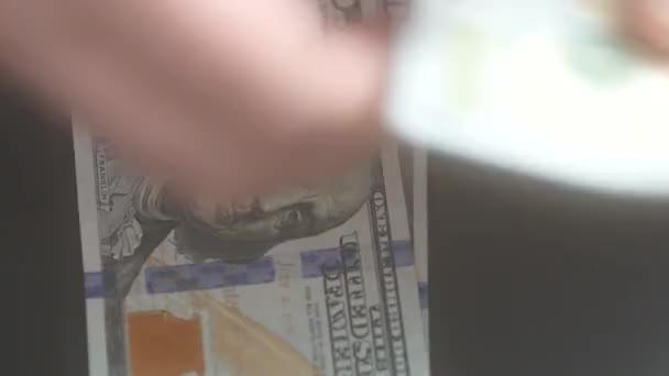 Rozostření, počítání peněz - nás 100 dolarů účty
