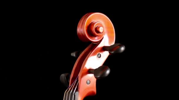 Lapozzunk a hegedű, vagy viola-val kampókat fordult a fekete háttér részlete