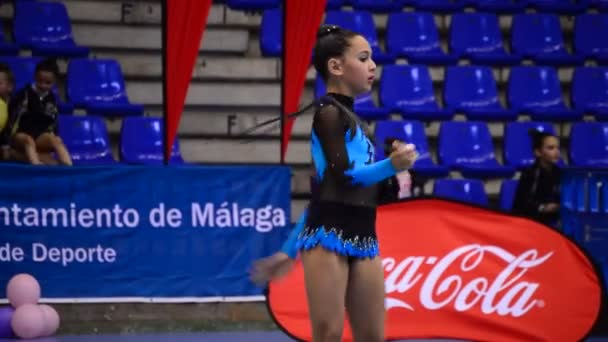 MALAGA/MALAGA/SPAIN - 05 16 2015: Young gymnast with string on rhythmic gymnastics tournament