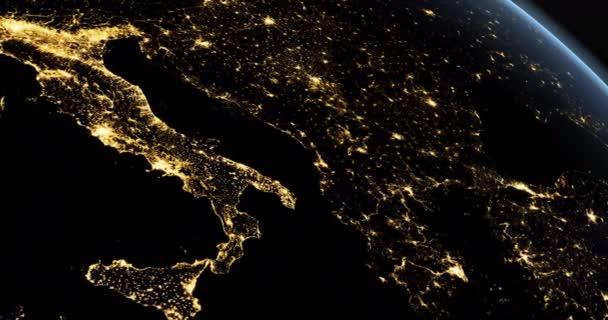 Pohled na Itálii v noci na zemské planetě rotující z vesmíru