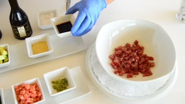 Chef hands mixing ingredients in a bowl