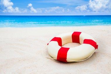 Life buoy on sand