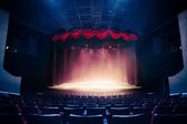 Fotografie Theater curtain with dramatic lighting