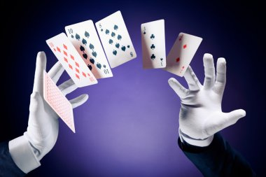 Magician making card tricks
