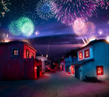 Typical mexican village at night with fireworks