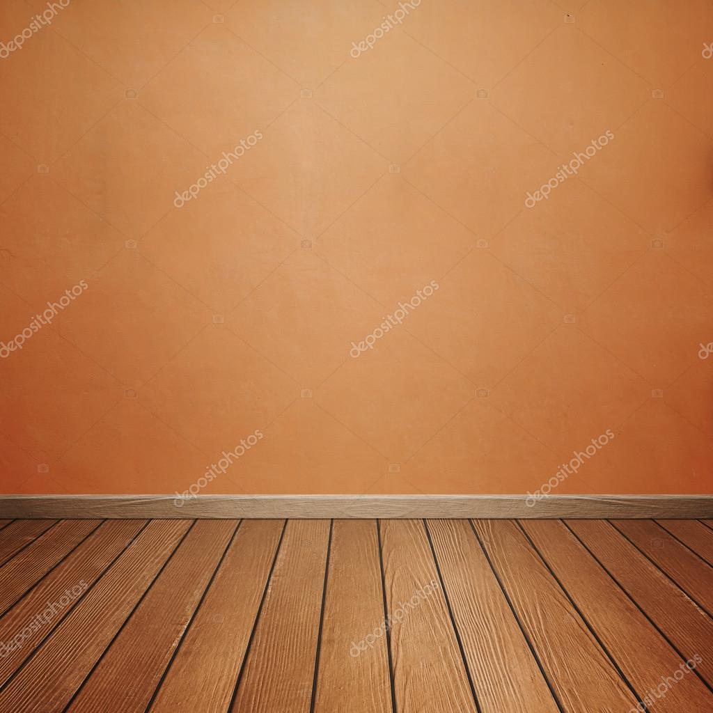 Interior Da Sala Com Parede De Concreto E Piso De Madeira Marrom  -> Piso Parede Sala