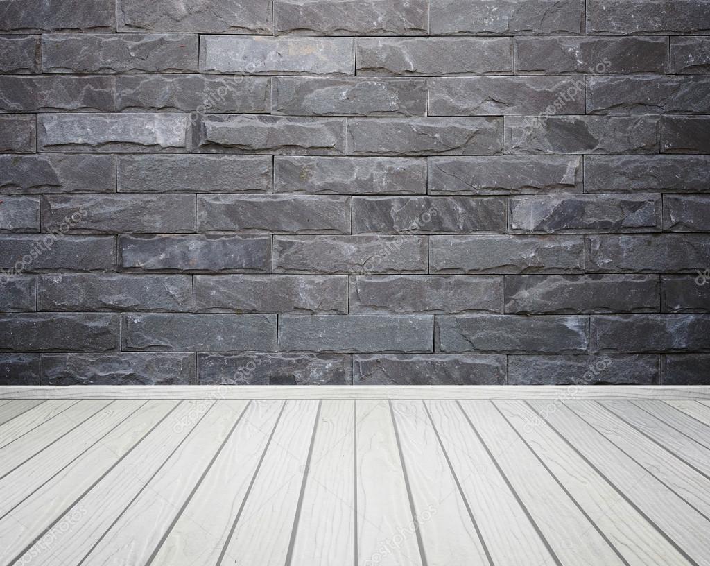 Sala interna con pietra mattoni piastrelle muro e legno pavimento