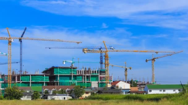 4k Time-lapse of Industrial construction crane with blue sky background