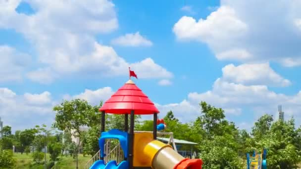 4k timelapse,clouds move or running over playground in the garden