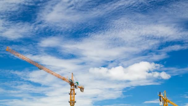 4k Time-lapse of construction crane and worker of building industry with blue sky