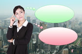 Thinking business woman with many ideas in empty bubble with cit